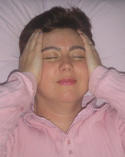 Kate Jones Reiki Master treating herself with Reiki