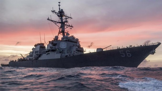 Ten missing after US destroyer collides with oil tanker