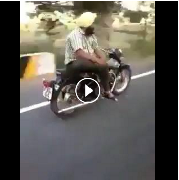 Among viral videos, there is a genre of men doing acrobatics on their bikes.  One of the most memorable of them is an old video of a Sikh man riding his bullet sideways, hands free, sitting on the pillion and reading a newspaper.