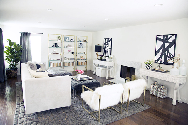 Pretty Little Details Inspiration Files // Beautiful white living room with bold black artwork.