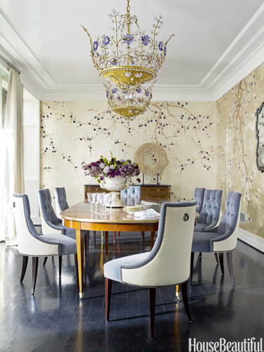 These tufted, velvet dining room chairs add a 60s design element to the space.