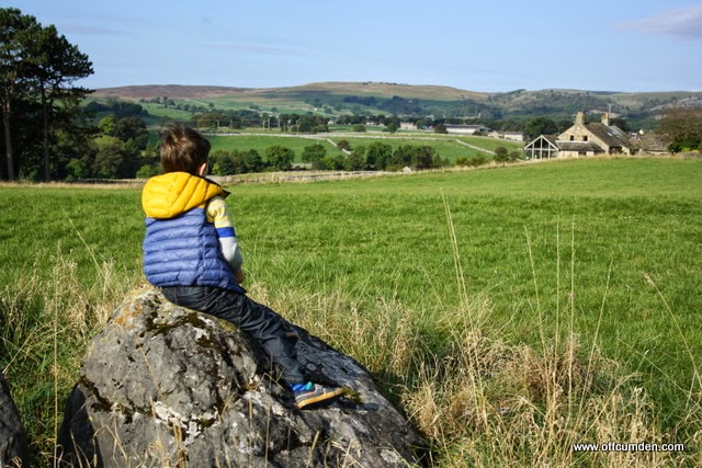 boy sitting on rock