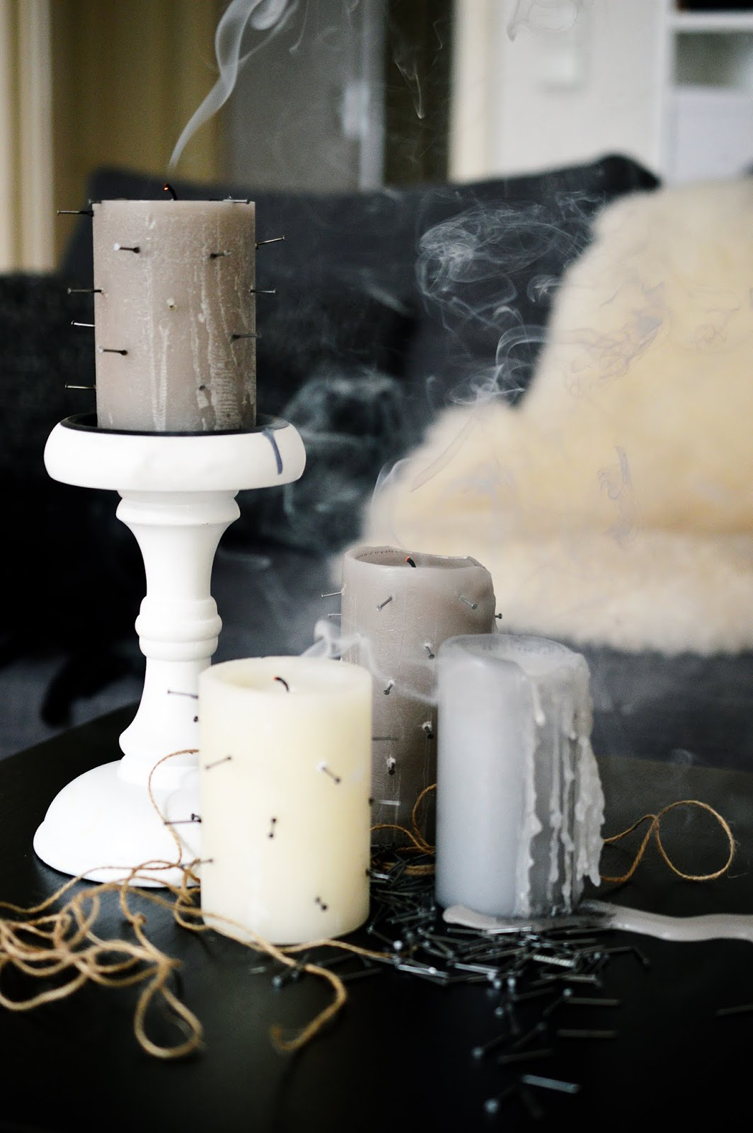 blown out candles with nails inserted in the sides for Halloween