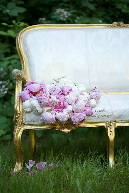 flowers and a vintage french settee