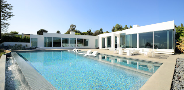 Modern home and swimming pool during the day