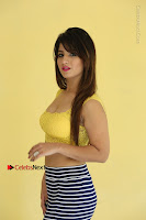 Cute Telugu Actress Shunaya Solanki High Definition Spicy Pos in Yellow Top and Skirt  0102.JPG