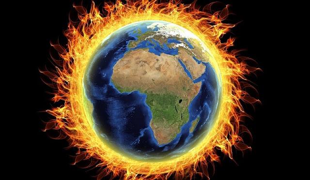 ilustrasi bumi yang terbakar akibat pemanasan global
