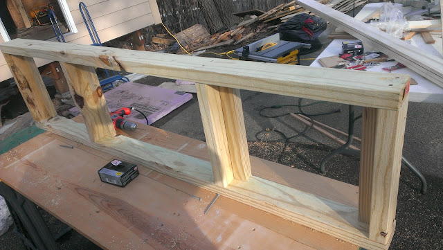 Sauna bench framing with blocking and L-corners to attach the top boards from underneath.
