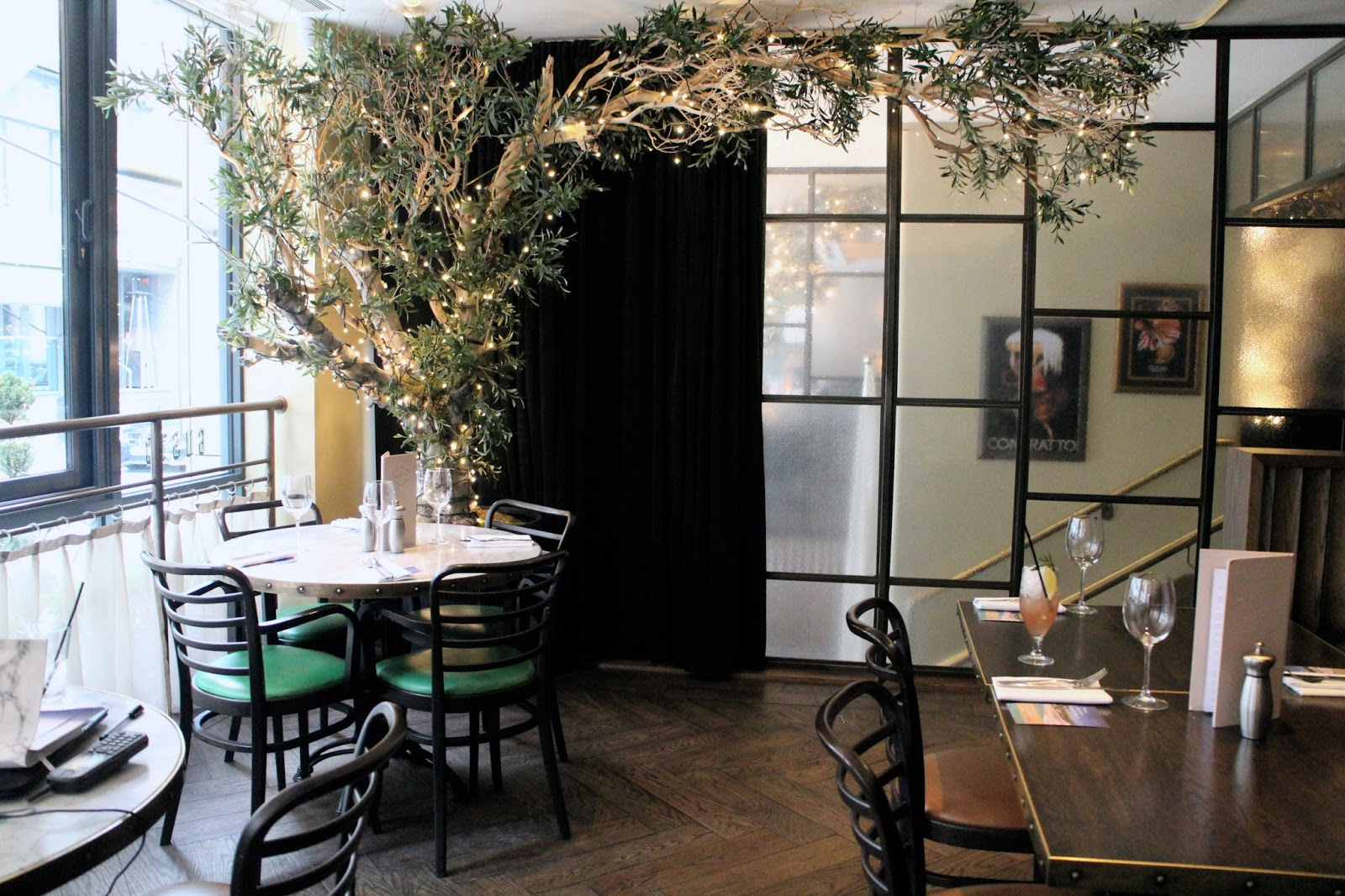 Foliage and fairy lights decor at Gusto Restaurants | The Dress Diaries