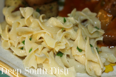 Egg noodles, seasoned simply, tossed with butter, Parmesan cheese and chopped fresh parsley.