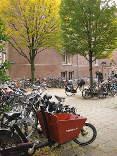 Bicycles parked in a small plaza, Amsterdam, The Netherlands