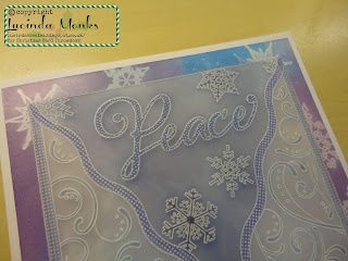 Parchment Christmas card, Peace and snowflakes, in blue, purple and pink, close up