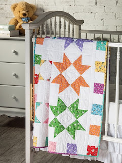 Color Burst Baby Quilt Pattern made using rainbow color fabric