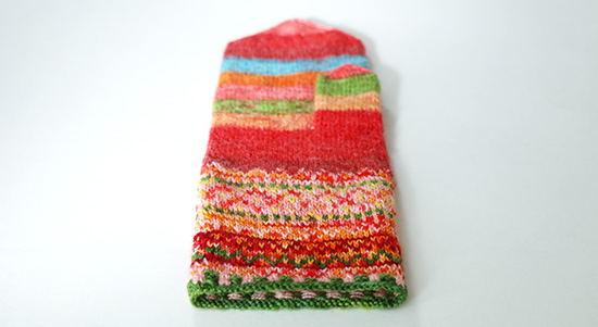 A Pair of Meida's Mittens Knit with Nontraditional Colors Viewed from the Cuff to the Tip
