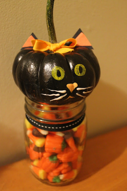 Make this adorable mini pumpkin candy jar, topped with a cute black cat!