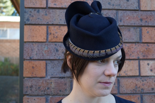 Navy wool felt blocked hat with pheasant feather
