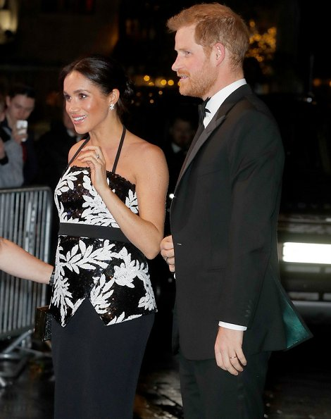 Meghan Markle wore Safiyaa Malaya Strapless Top and black satin maxi pencil skirt. Birks snowflake snowstorm diamond earrings