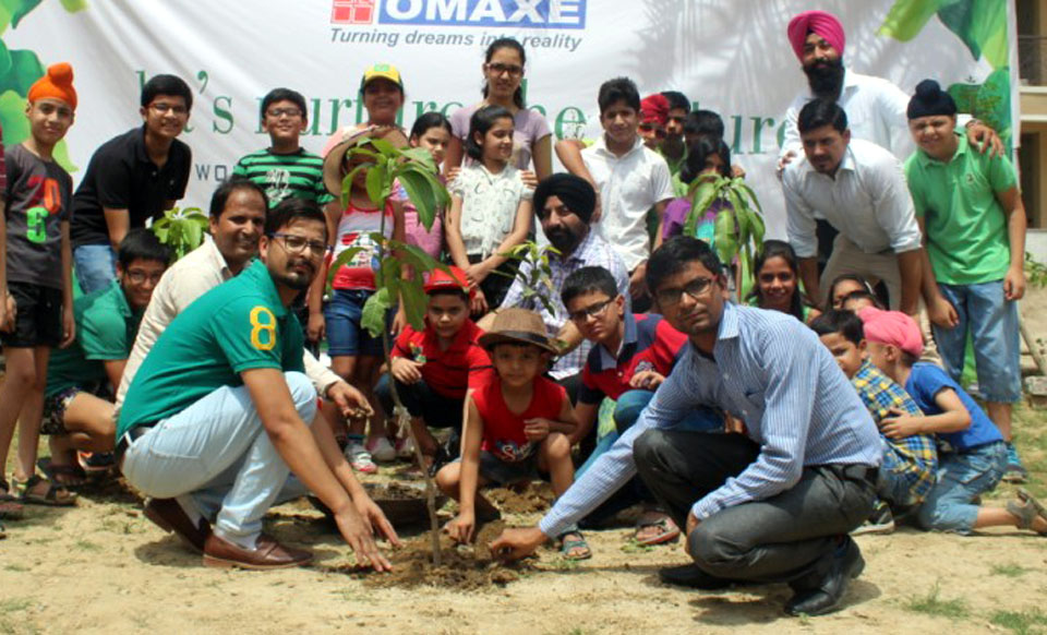 Guest with Children planting tree during Mega Tree Plantation Drive at Omaxe Royal Residency