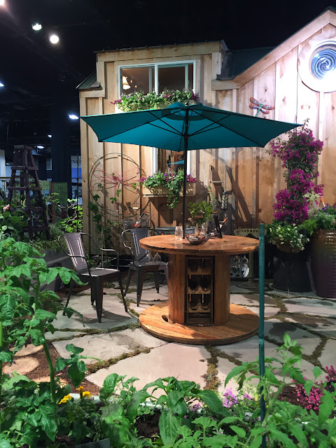 Who would have thunk it?  Patio table & wine storage combo | Boston Flower Show Inspo