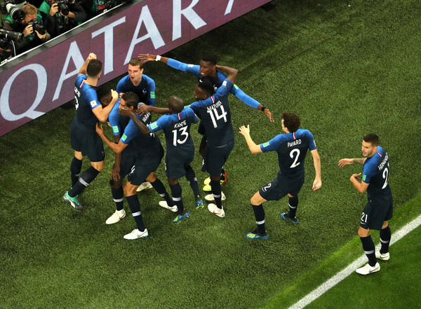 Samuel Umtiti of France celebrates with teammates after scoring his team's first goal during the 2018 FIFA World Cup Russia Semi Final match between Belgium and France at Saint Petersburg Stadium on July 10, 2018 in Saint Petersburg, Russia.