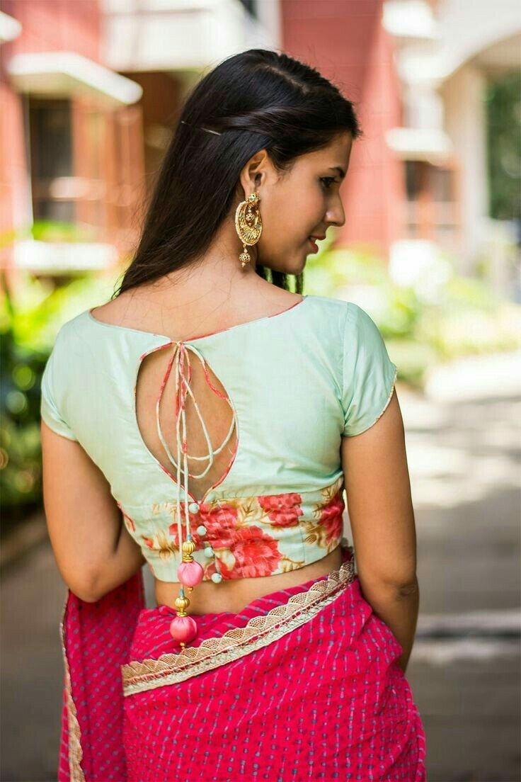 e6f3e0f627d0 This stylish boat neck blouse with an oval back cut out is perfetc for any  party wear silk saree. The blouse plays the contrast colour play with a bit  of ...