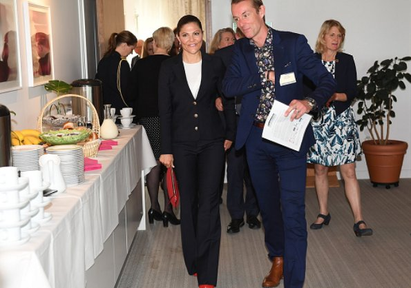 Crown Princess Victoria attended the meeting of Swedish Leadership for Sustainable Development at Sida headquarters. House of Dagmar clutch bag, Dagmar red suede pumps