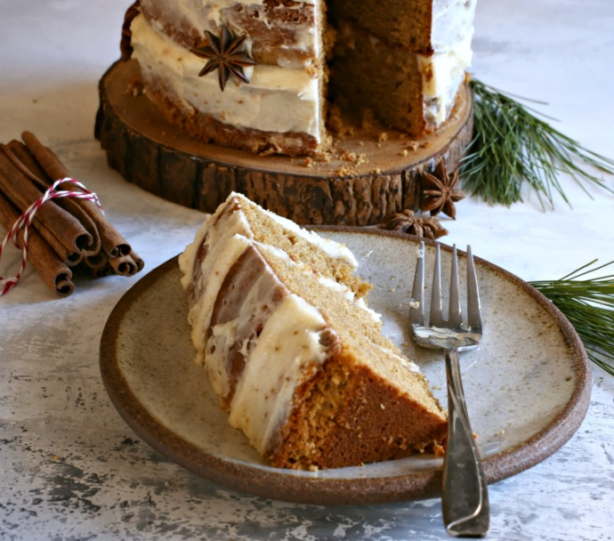Gingerbread layer cake covered in tahini cream cheese frosting.