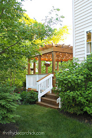 Deck and pergola with white railings