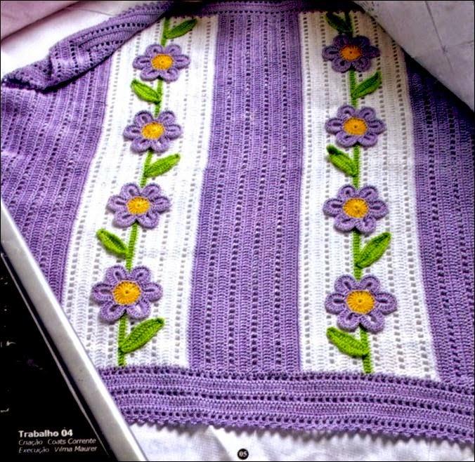 Manta tejida con ganchillo con lindos apliques florales