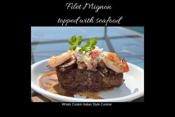 this is a grilled filet mignon piece of beef with shrimp , crab and wine sauce on top sitting on a white plate over looking a pool deck
