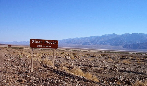 Flash flood next 55 miles road sign