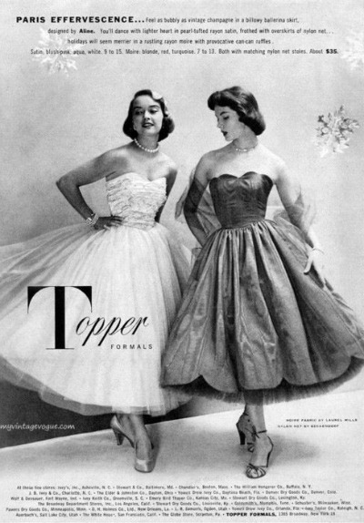 Two models in prom or cotillion dresses in advertisement for Topper Dresses