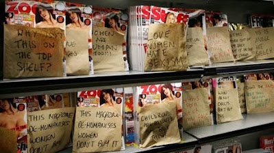 """THIS MAGAZINE DE-HUMANISES WOMEN - DON'T BUY IT"".  The students at the Oxford Student Union placed covers over the Lads Magazines.  They left the Women's Chat magazines alone, presumably because they only de-humanise men."