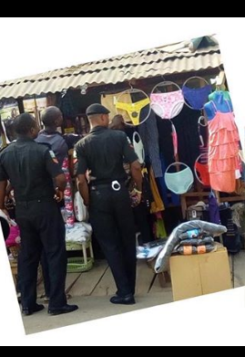 Nigerian Police Spotted Buying Panties In Lagos