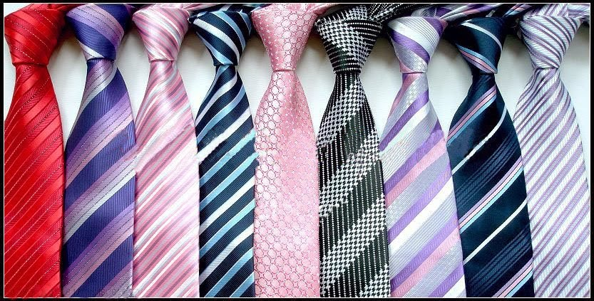 bc1ae4a82487 A tie or necktie is a long piece of cloth worn for decorative purposes  around the neck or shoulders, resting under the shirt collar and knotted at  the ...