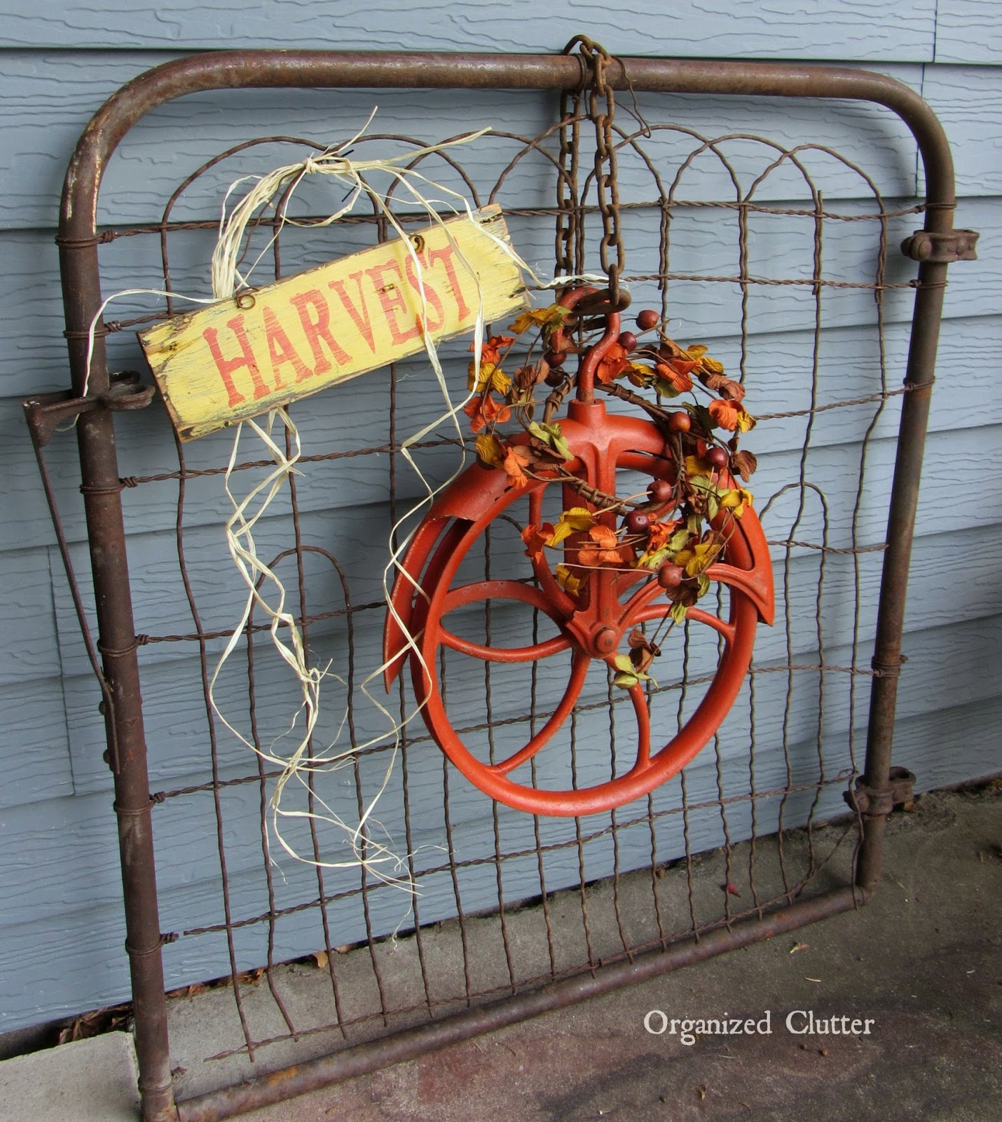 Autumn Pulley Wreath on a Rusty Gate www.organizedclutterqueen.blogspot.com