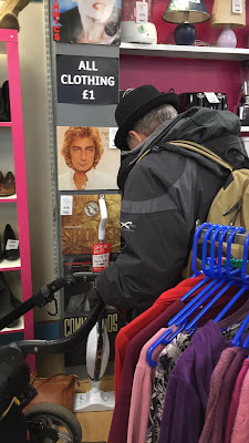 Man looking at Barry Manilow record in Burnham-On-Sea charity shop