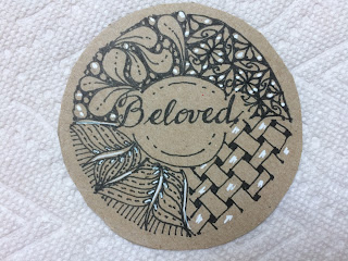 """Tan circle with Zentangle design and word """"Beloved"""" in black ink with white accents"""