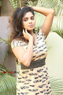 Telugu Actress Karunya Chowdary Stills in Short Dress at ATM Not Working Press Meet  0057.jpg