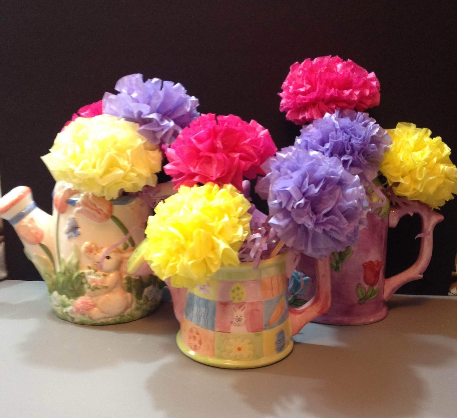 But We Couldnt Find Any Really Cute Teapots So My Second Choice Was Watering Cans In Spring Like Colours
