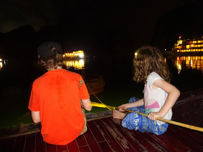 The two calm squid fishing kids on Halong cruise