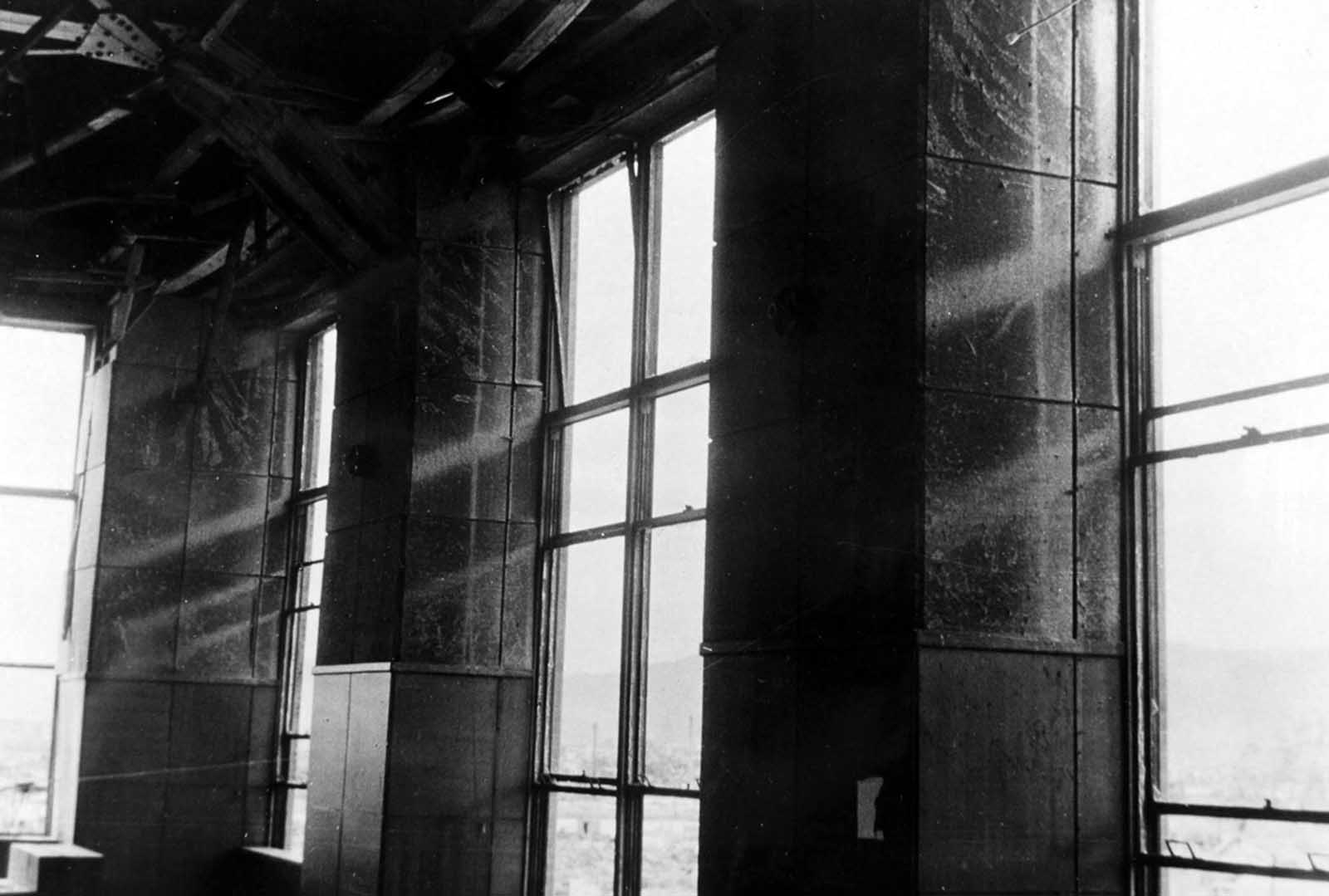 Post office savings bank, Hiroshima. Shadow of window frame left on fiberboard walls made by the flash of the detonation. October 4, 1945.