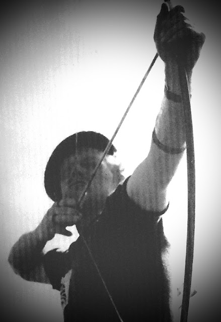 """Mad Jack"" Churchill, pulls back a bow while competing in the 1939 Archery World Championships in Oslo, Norway. Overstreet and Mad Jack and other stories of pilots. marchmatron.com"