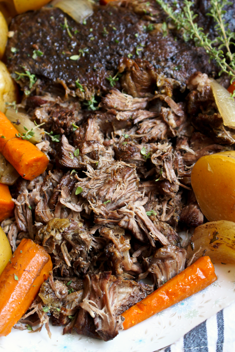 This Perfect Slow Cooker Pot Roast is simmered in the slow cooker to tender perfection!  It is a classic no-fuss dinner that is great for busy weeknights or Sunday supper. #potroast #chuckroast #dinnerrecipe #slowcooker