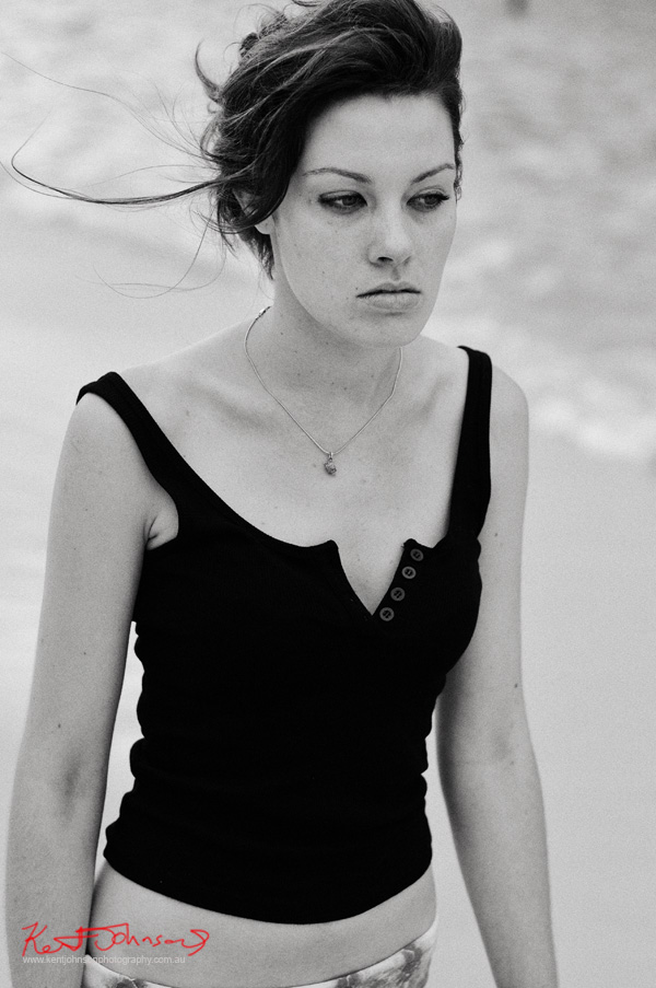 Bridget, walking on the beach, black and white photograph for a modelling portfolio - Photographed by Kent Johnson, Sydney, Australia.