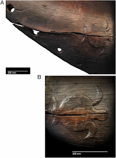 Carving of a sea turtle on the Anewaka canoe plank