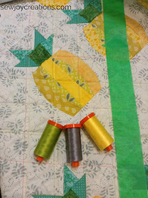 aurifil thread on mini pineapple quilt