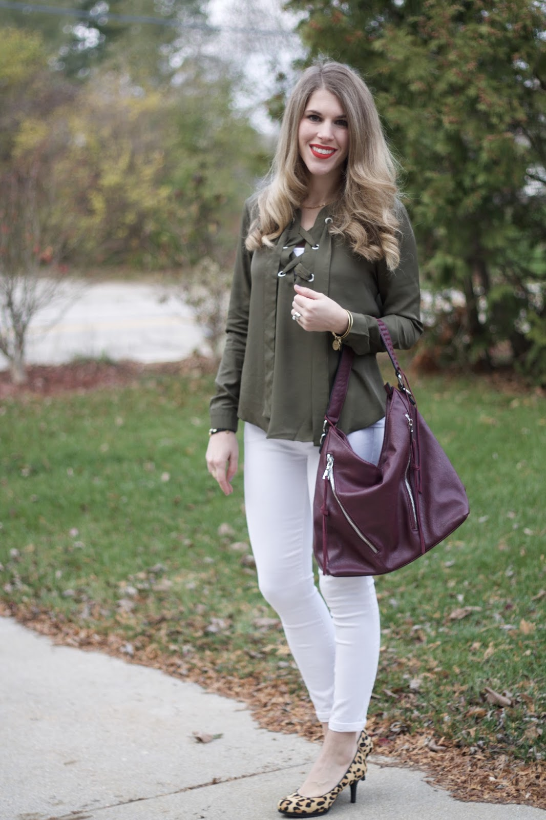 olive lace up longsleeve top, white skinny jeans, leopard pumps, burgundy bag, casual fall outfit, white jeans for fall
