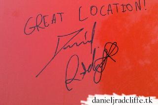 Daniel signs lawnmower while filming Jungle in Australia