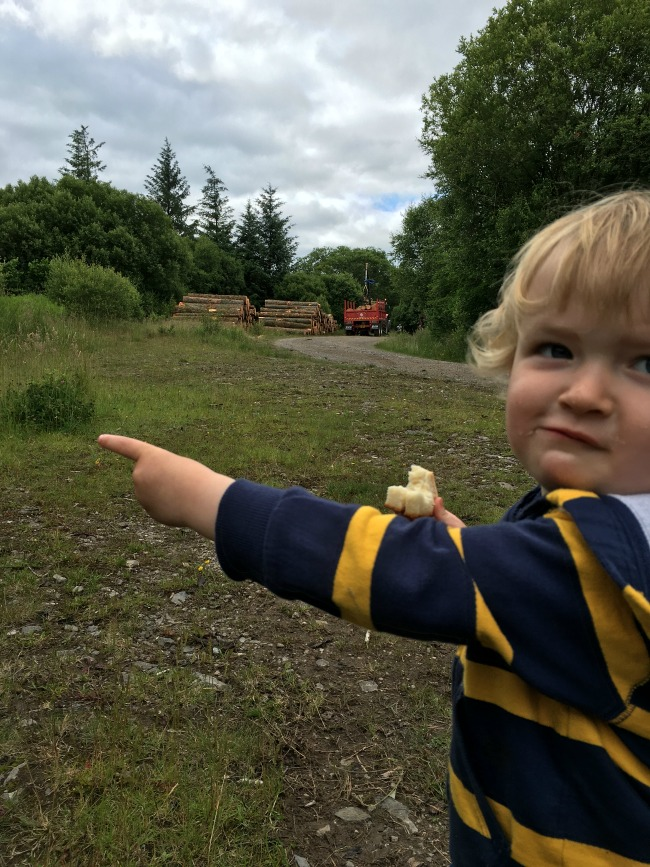Garwnant-Visitor-Centre-A-Toddler-Explores-toddler-pointing-at-tractor